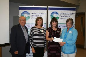 John Lawrence, Ruth Hook from the Chatham-Kent Community Foundation, Chatham-Kent Hospice Foundation Executive Director Jodi Maroney and Pat Murray from South Kent Wind.